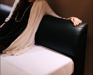 lady-leaning-on-leather-bed