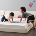 children-on-leather-bed